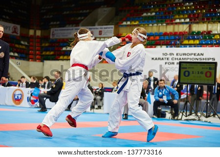 MOSCOW - JUN 9: Female fighter attacks opponent in head during fight at 10th Team Championship of Europe on karate at OC Luzhniki, Small sports arena, June 9, 2012, Moscow, Russia.