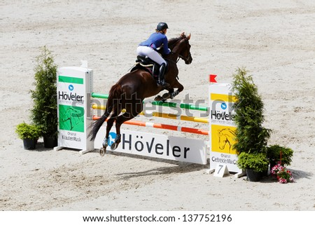 MOSCOW - JUN 9: Female participant of international competitions in show jumping CSI3 Vivat, Russia in equestrian center Bitsa, Jun 9, 2012, Moscow Russia. Prize fund of competition was 114 500 euros. - stock photo