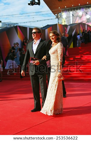 MOSCOW - JUNE 20, 2013: Actor Marat Basharov and Anna Sazonova at XXXV Moscow International Film Festival red carpet opening ceremony.