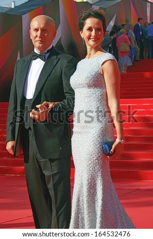 MOSCOW - JUNE 29: Actress Olga Kabo with her husband at XXXV Moscow International Film Festival red carpet closing ceremony. Taken on June 29, 2013 in Moscow, Russia.