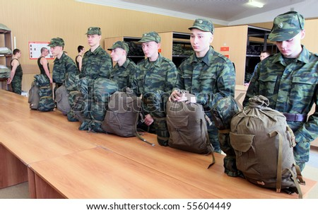 MOSCOW - JUNE 18: Army conscripts receive military uniform, a collection point, June 18, 2010 in Moscow, Russia. - stock photo