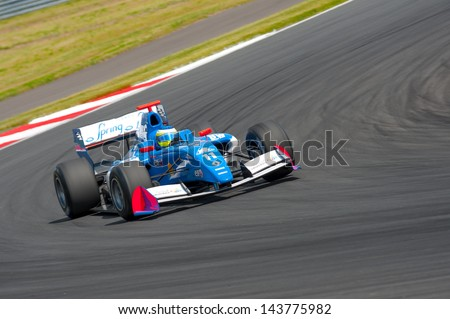 MOSCOW - JUNE 23: Carlos Huertas of Carlin team (GBR) race at Formula Renault 3.5 race at World Series by Renault in Moscow Raceway on June 23, 2013 in Moscow - stock photo