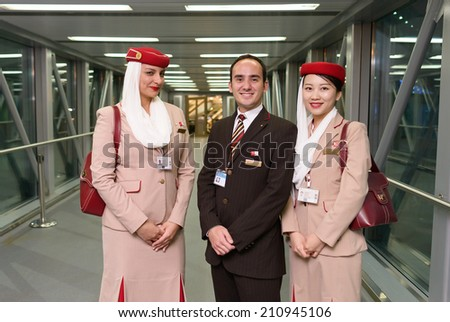 MOSCOW -JUNE 04: Emirates crew members after landing on June 04, 2014 in Moscow, Russia. Emirates handles major part of passenger traffic and aircraft movements at the airport. - stock photo