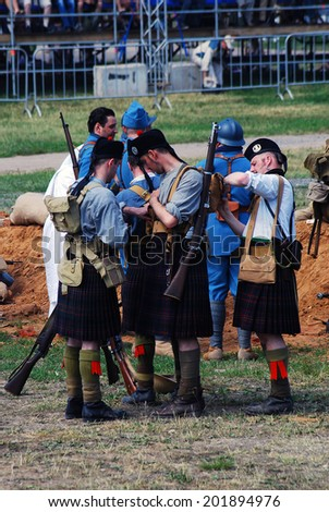 MOSCOW - JUNE 08, 2014: Men in Scottish kilts. First World War battle historical reenactment. Times and Ages International Historical Festival in Kolomenskoye park, Moscow.