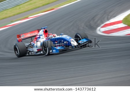 MOSCOW - JUNE 23: Mikhail Aleshin of Tech 1 R team (FRA) race at Formula Renault 3.5 race at World Series by Renault in Moscow Raceway on June 23, 2013 in Moscow - stock photo