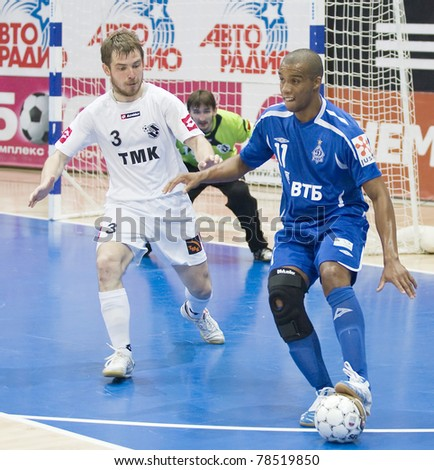MOSCOW - JUNE 2, Russian Futsal championship, play-off games Dinamo vs. Sinara, final on June 2, 2011 in Moscow. Cirilo (Dinamo) is controlling a ball. - stock photo