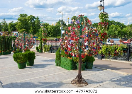 MOSCOW - JUNE 10, 2016:Trees with locks of lovers on a trees at Tretyakovsky bridge