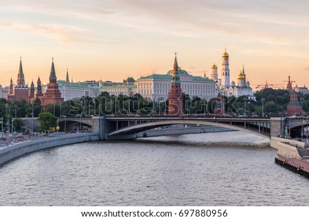 Moscow Kremlin and Moscow River in the sunny evening. Pink and golden sky. Russia