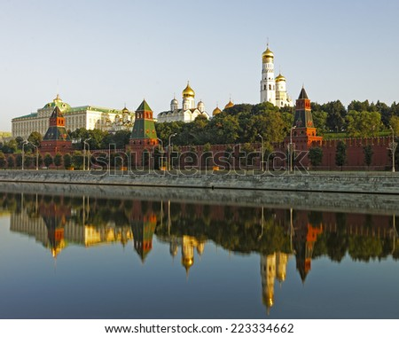 Moscow Kremlin and three towers reflected view in river - stock photo