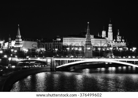 Moscow Kremlin. Night scene. The Moscow river embankment. Moscow Kremlin is a UNESCO World Heritage Site. Black and white photo. - stock photo