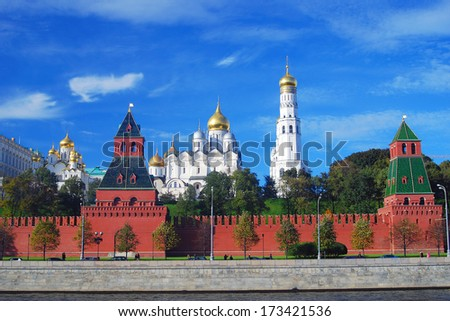 Moscow Kremlin panorama in summer: the Big Kremlin Palace, Ivan the Great Bell Tower, the Moscow river embankment. Blue sky with clouds background.