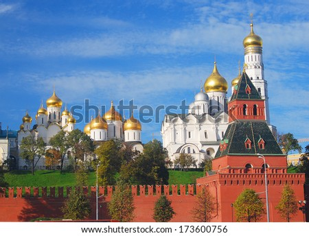 Moscow Kremlin panorama in summer: the Big Kremlin Palace, Ivan the Great Bell Tower, the Moscow river embankment. Blue sky with clouds background. - stock photo