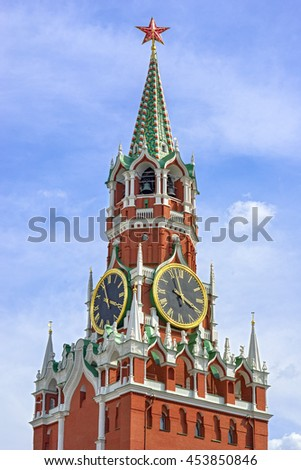 Moscow Kremlin, Red Square. Spasskaya (Savior's) clock tower decorated by the red ruby star on the top of it. Blue sky background. UNESCO World Heritage Site. - stock photo