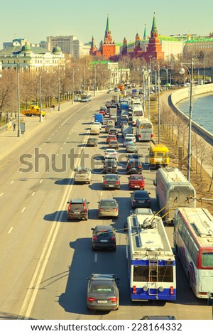 Moscow Kremlin, the traffic jam to the center. Photo toned in yellow - stock photo