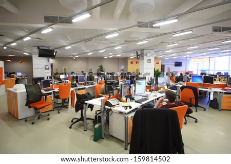 MOSCOW - MAR 5: Employees work in office buildings news agency RIA Novosti with orange furniture on March 5, 2013 in Moscow, Russia. - stock photo