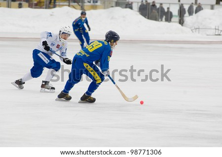 MOSCOW - MARCH 17: Befus Yury(L) and Anufriev Nikolay(R) compete in a semifinal game Dynamo(w) vs Zorkij(b) of Bandy Championship of Russia on March 17, 2012 in Krasnogorsk, Russia. Dynamo won 6:3