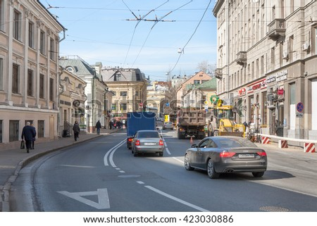 MOSCOW - MARCH 29: Cars on Solyanka street on March 29, 2016 in Moscow. Solyanka is one of the oldest streets in Moscow.