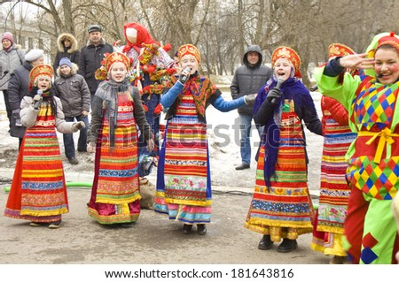 MOSCOW - MARCH 2 2014: maslenitsa (pancake week, shrovetide) - carnival of farewell winter and meeting spring in Moscow, folk artists on street.  - stock photo