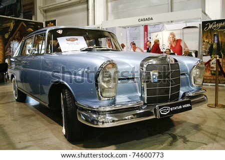 MOSCOW - MARCH 25: Mercedes-Benz W111 230S on display at at the Moscow Exhibition of technical antiques on March 25, 2011 in Moscow, Russia. - stock photo