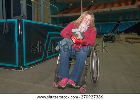 MOSCOW - MARCH 13: participants of the International Social and charitable project MOTOTERAPIA for people with disabilities on March 13, 2015, in Moscow, Russia. Sports Complex Olimpiyskiy - stock photo