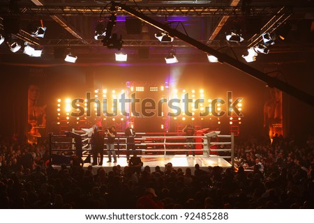 MOSCOW - MARCH 12: People stand at boxing ring before fight at Fight Nights Battle of Moscow-3 in Crocus City, on March 12, 2011 in Moscow, Russia. - stock photo