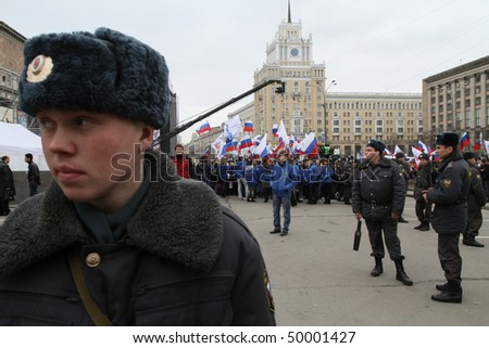 "MOSCOW - MARCH 31: Police on stand by during ""Generation Against Terror"" anti-terror demonstration at Triumphal Square on March 31, 2010 in Moscow."