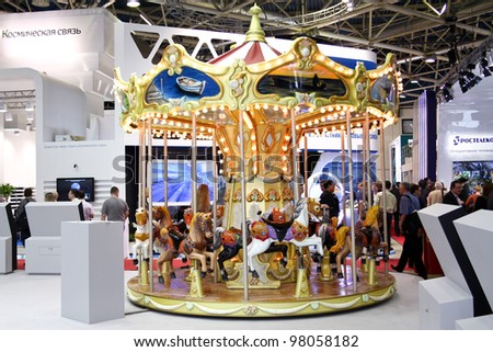 MOSCOW-MAY 11: Antique Carrousel at the international exhibition of the telecommunications industry Sviaz-Expocomm on May 11, 2011 in Moscow - stock photo
