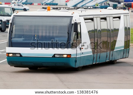 MOSCOW - MAY 22:  Bus for transportation of passengers in airport Domodedovo, May 22, 2012, Moscow, Russia. Domodedovo airport - largest and most modern airport in Russia. - stock photo