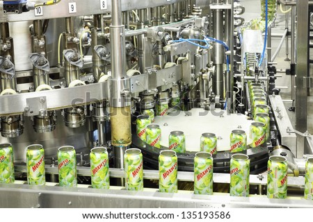 MOSCOW - MAY 16: Cans mojitos on conveyor in Ochakovo factory, on May 16, 2012 in Moscow, Russia. Ochakovo has breweries in several Russian cities - Moscow, Krasnodar, Tyumen, Penza. - stock photo