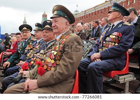 MOSCOW - MAY 09: Celebration of the 66th anniversary of the Victory Day (WWII) on Red Square on May 9, 2011 in Moscow, Russia. Veterans of the WWII sit on the podium