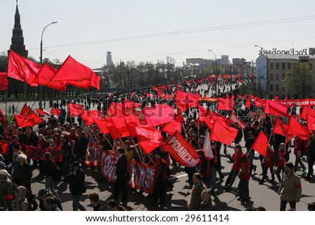 MOSCOW - MAY 1:  Communist supporters walk past the Kremlin during International Workers' Day, or Labour Day celebrations May 1, 2009 in Moscow, Russia.