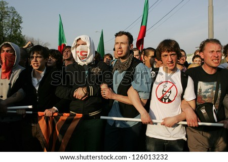 MOSCOW - MAY 6: Demonstrators against newly elected president Vladimir Putin shout slogans on May 6, 2012 in Moscow, Russia. - stock photo