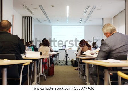 MOSCOW - MAY 22: Employees at business meeting of Efes Rus company at Small Dmytrivka, 20, on May 22, 2013 in Moscow, Russia. - stock photo