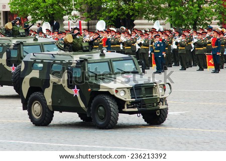 "MOSCOW - 6 May 2010: GAZ-233014 ""Tiger"". Dress rehearsal of Military Parade on 65th anniversary of Victory in Great Patriotic War on May 6, 2010 on Red Square in Moscow, Russia - stock photo"