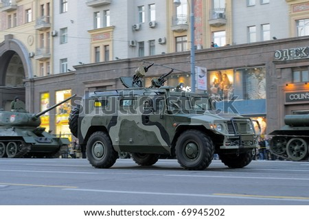 "MOSCOW - MAY 6: GAZ-233014 ""Tiger"". Dress rehearsal of Military Parade on 65th anniversary of Victory in Great Patriotic War on May 6, 2010 on Red Square in Moscow, Russia - stock photo"