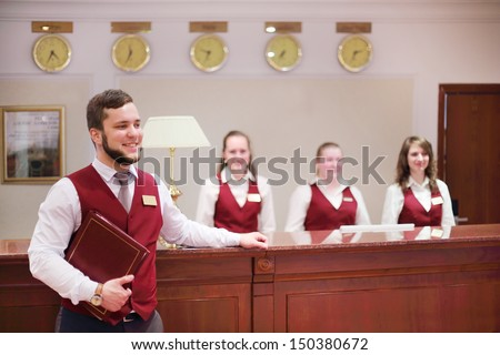 MOSCOW - MAY 22: Happy receptionists at counter for guests in Bogorodino hotel, on May 22, 2013 in Moscow, Russia. Four-star Borodino hotel was built in 2007. - stock photo