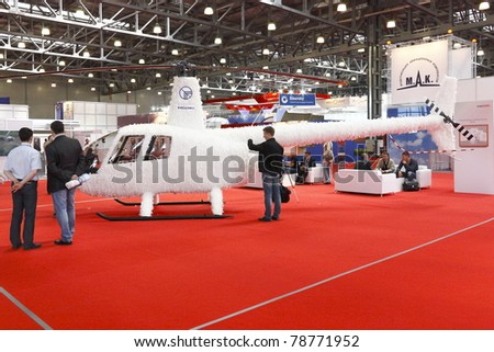 MOSCOW-MAY 21:Helicopter R44 White Eagle(concept) American Company Robinson Helicopter  on the 4-th International Exhibition of Helicopter Industry on May 21, 2011 in Moscow