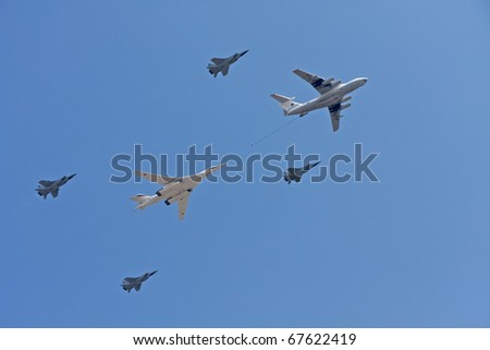 MOSCOW - MAY 9: Il-78 refueling tanker with Tu-160 strategic bomber and Mig-31 supersonic interceptor on parade devoted to 65th anniversary of victory in Great Patriotic war on May 9, 2010 in Moscow.