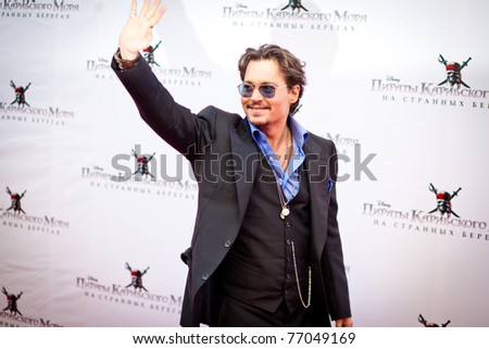 """MOSCOW - MAY 11: Johnny Depp arrives to the """"Pirates of the Caribbean: On Stranger Tides"""" Premiere on May 11, 2011, Moscow, Russia - stock photo"""