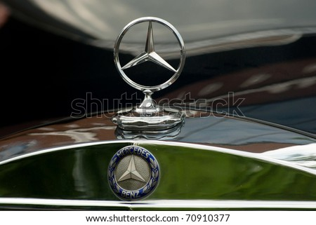 MOSCOW - MAY 15: Mercedes-Benz emblem logo on exhibition at Mercedes-Benz Classic Day-2010, massive oldtimer rally, Moscow, Russia, on May 15, 2010 - stock photo