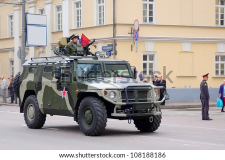 """MOSCOW-MAY 9: Military transport GAZ-2330 """"TIGER"""" at the Victory Day Parade on May 9, 2012 in Moscow - stock photo"""