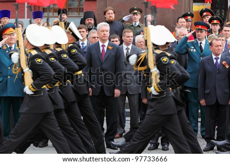 MOSCOW - MAY 8: Moscow Mayor Sergei Sobyanin, State Duma deputies and veterans look military parade at Victory Day, on May 8, 2011, Moscow, Russia. - stock photo