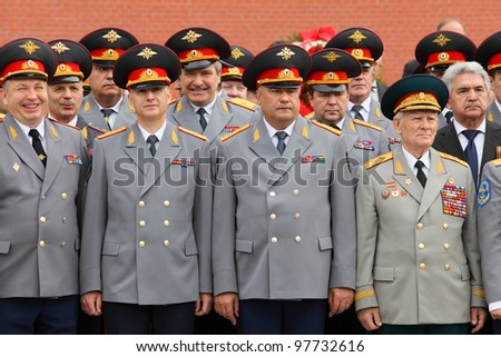 MOSCOW - MAY 8: Officers and veterans stand at ceremony of wreath laying at tomb of Unknown Soldier at Victory Day celebrations, on May 8, 2011, Moscow, Russia. - stock photo