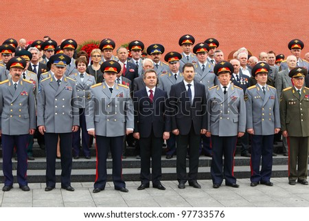 MOSCOW - MAY 8: Officers and veterans stand near Kremlin wall at ceremony of wreath laying at tomb of Unknown Soldier at Victory Day celebrations, on May 8, 2011, Moscow, Russia. - stock photo
