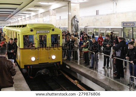 MOSCOW - MAY 5, 2015: People look vintage subway cars at the exhibition of retro-cars dedicated to the 80th anniversary of the Moscow Metro. Public-event