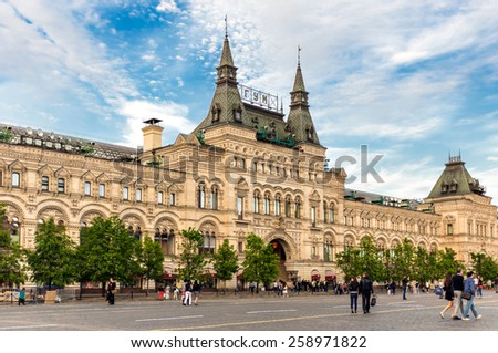 MOSCOW - MAY 16: People walking on the Red Square near GUM on May 16, 2014 in Moscow. GUM is the name of the department store in cities of the former Soviet Union, known as State Department Store. - stock photo