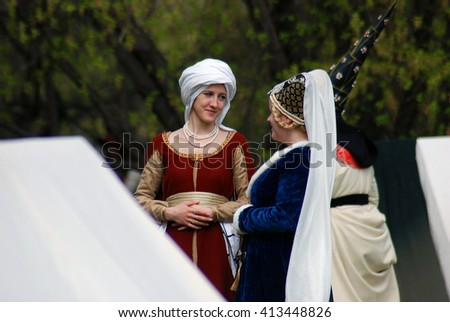 MOSCOW - MAY 02, 2015: Portrait of a people in historical costumes. Historical festival Saint George Tournament in Kolomenskoye park, Moscow.