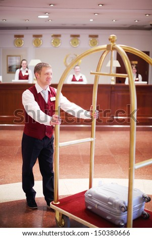 MOSCOW - MAY 22: Receptionist carries bag on cart in Bogorodino hotel, May 22, 2013, Moscow, Russia. Four-star Borodino hotel located near Sokolniki Park and is modern building with elegant interiors. - stock photo