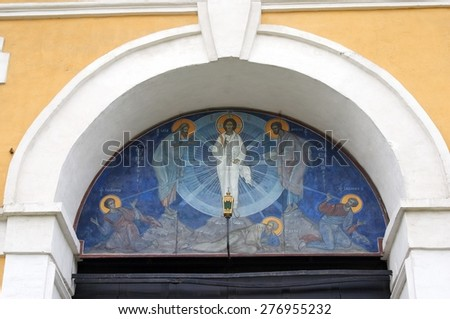 MOSCOW - MAY 11. 2015: Religious painting on a church facade. Novospassky monastery in Moscow, Russia. Popular touristic landmark. - stock photo