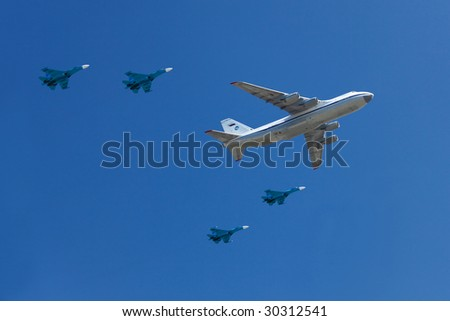 MOSCOW - May 9: Russian Air Force airplanes (Transport aircraft Antonov A-124 Ruslan and jet fighters Su-27) at Moscow Victory Parade on May 9, 2009.